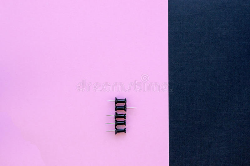Black thumbtacks pinned arrange to symbolize to be different or leadership with copy space royalty free stock image