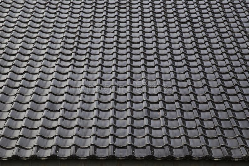 Black tiled roof for background usage. Texture and background stock images