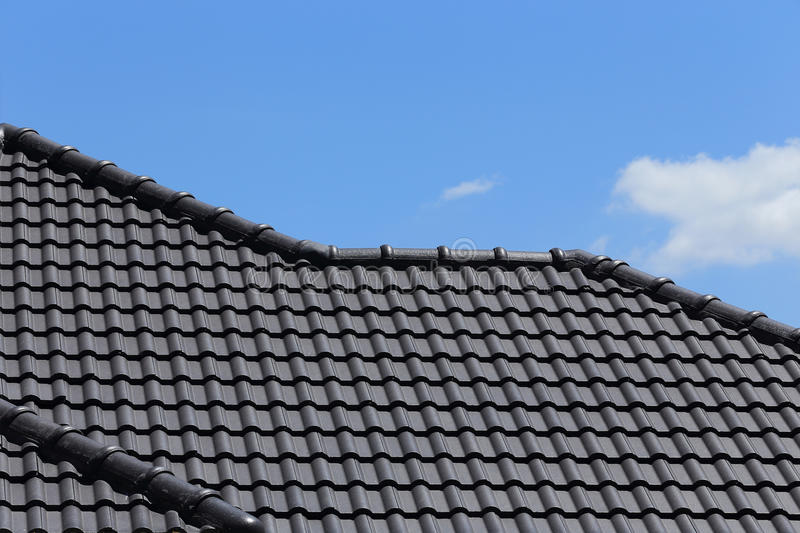 Black tiles roof on a new house royalty free stock photos