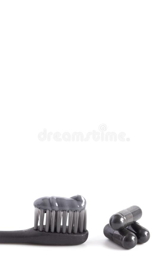 Black Toothpaste with Capsule of Activated Charcoal. A Black Toothpaste with Capsule of Activated Charcoal royalty free stock photos