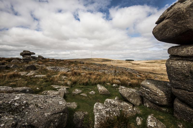 Black Tor on Dartmoor, Devon, England. The granite outcrop of Black Tor in the middle of Dartmoor National Park in Devon, England. A beautiful and wild landscape royalty free stock photos