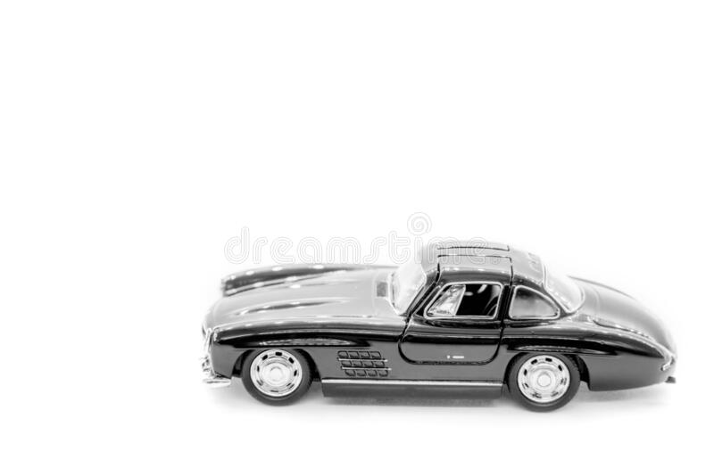 Black toy car isolated on white. Black toy car mercedes benz, isolated on white royalty free stock photos