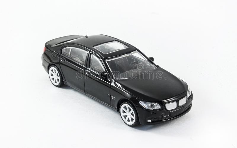 Black toy metal car on a white background. Children toy royalty free stock photos