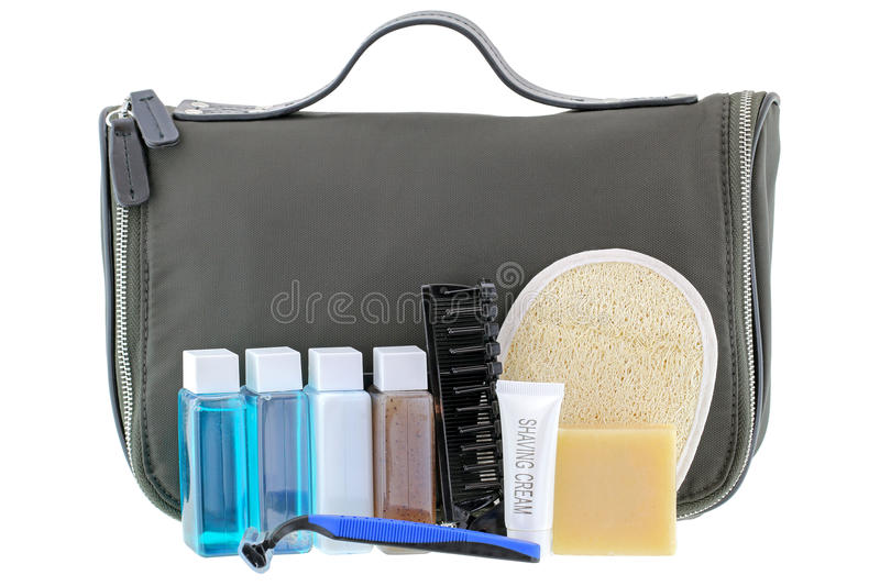Black traveling cosmetic bag with toiletries, isolated on white. Black traveling cosmetic bag with toiletries in the front, isolated on white royalty free stock photo