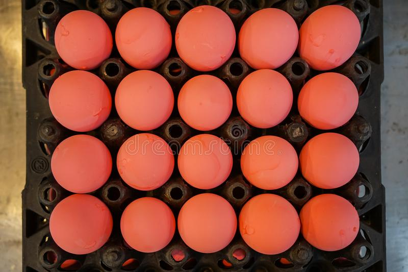 Black trays full of sweet pink color preserved chicken eggs rows pattern selling in local market, top view selective focus royalty free stock photography