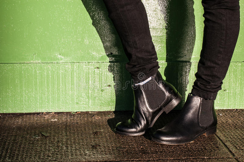 Black trousers and ladies vintage boots. Model wearing black trousers and ladies vintage boots with low heel (short Chelsea ankle) on the street royalty free stock photography