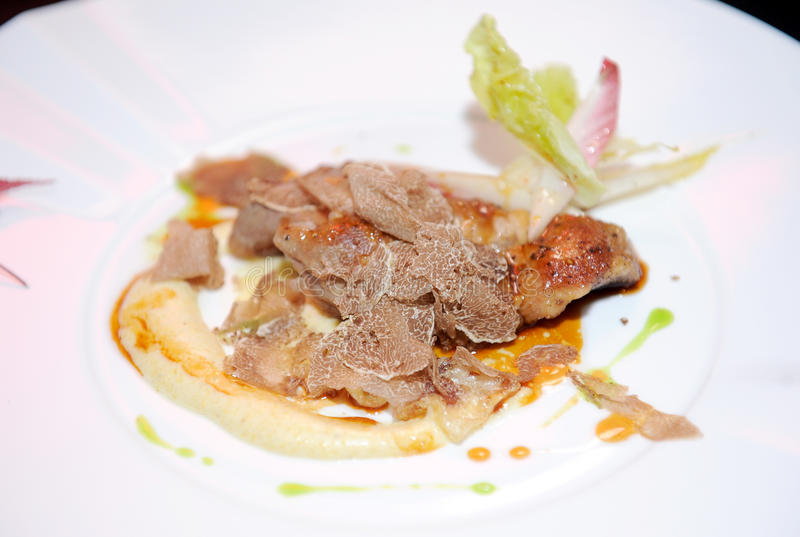 Black truffles. Close up steak and black truffles stock image