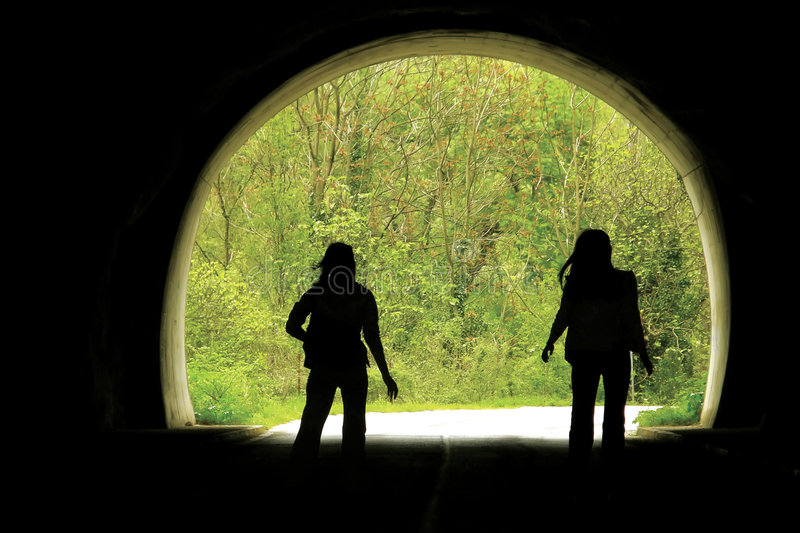 Black tunnel and people stock photography
