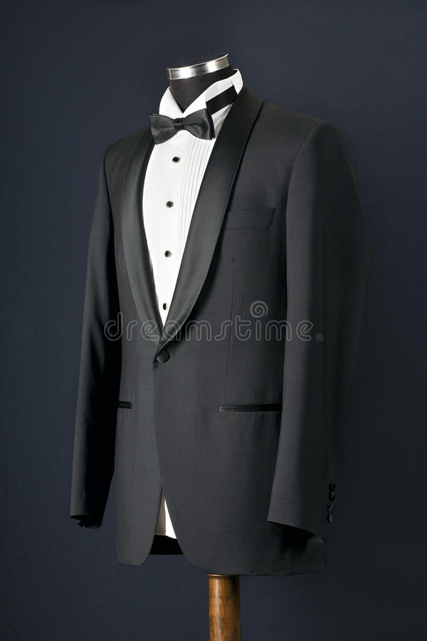 Black tuxedo. Front view of black tuxedo tie and white shirt royalty free stock image