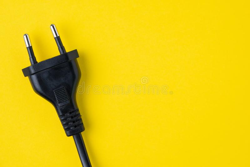 Black type C electric plug connector on yellow background with c royalty free stock images