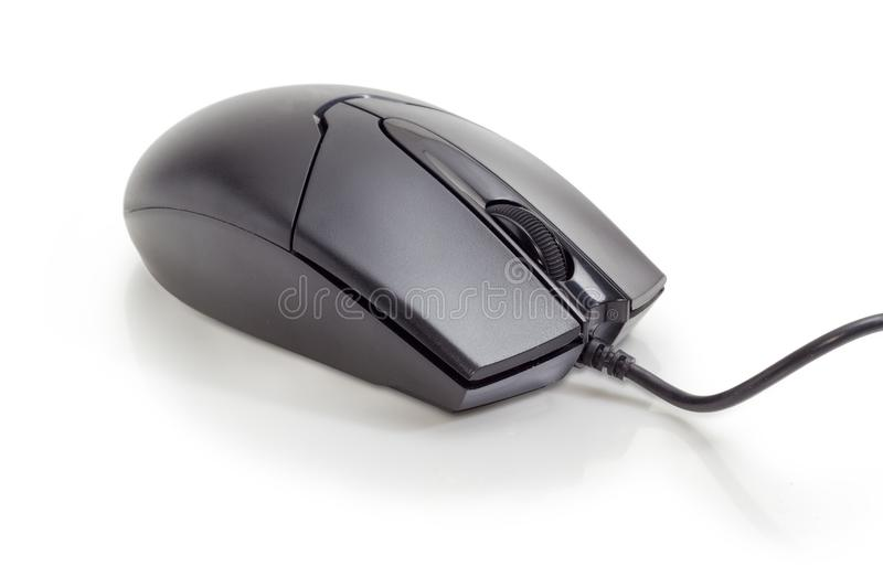 Black typical cabled computer mouse on a matte surface closeup. Modern black typical cabled optical computer mouse with two buttons and a scroll wheel on a matte royalty free stock photos