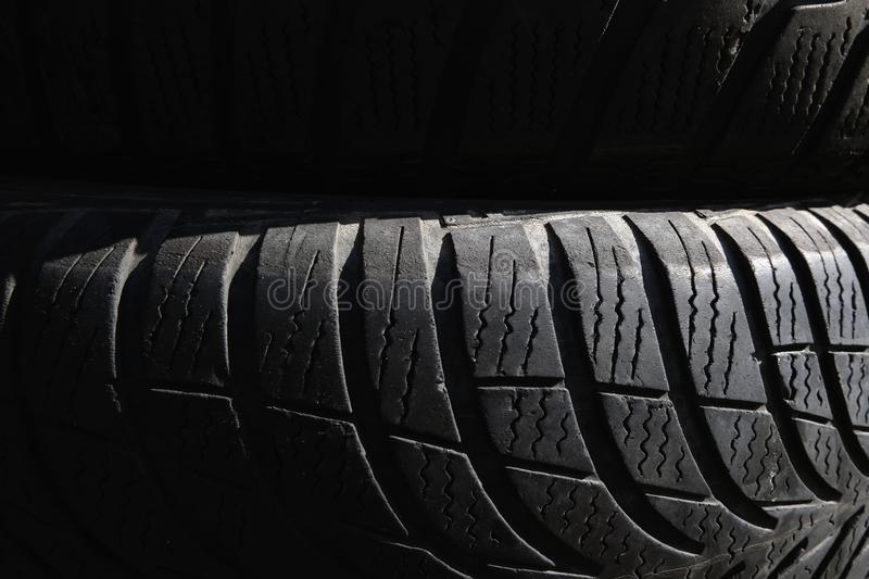 Black tyres background picture. Black texture, backdrop stock image
