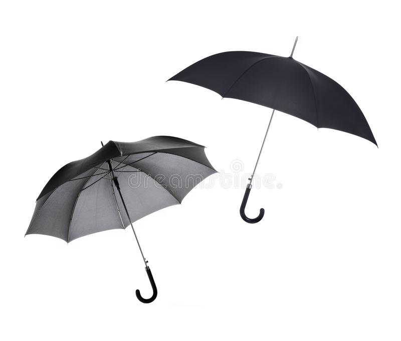 Black umbrellas royalty free stock photography