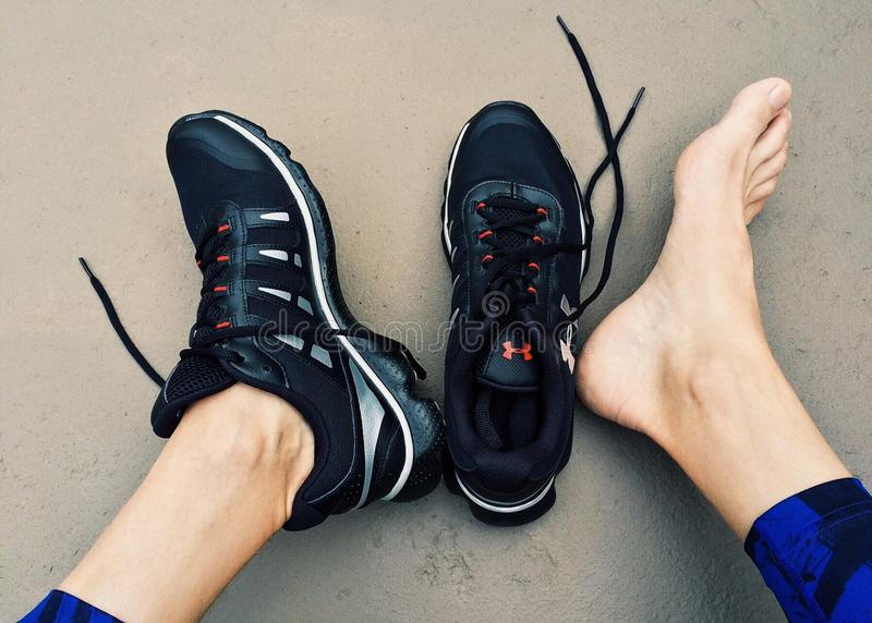 Black Under Amour Sneakers royalty free stock image
