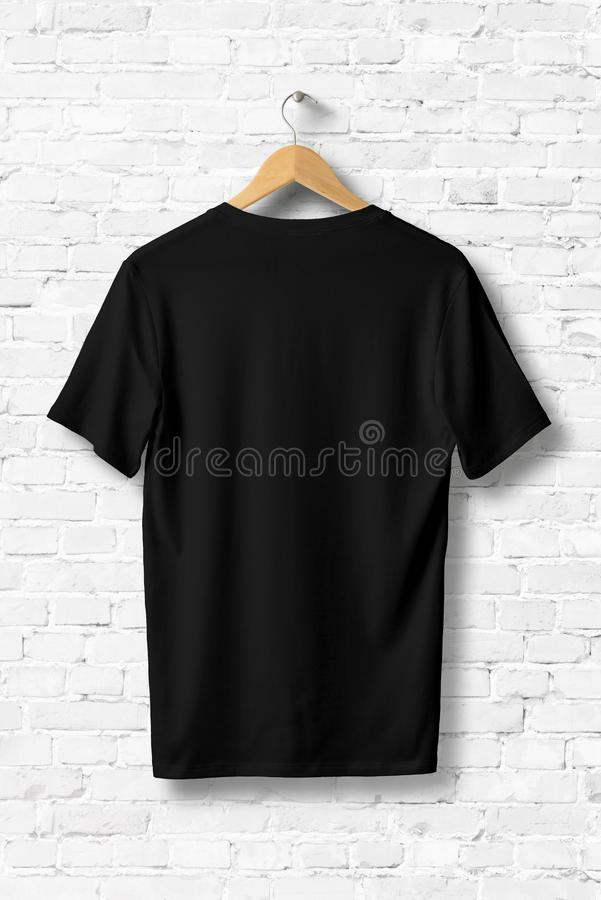 Black V-Neck Shirt Mock-up hanging on white wall. royalty free illustration