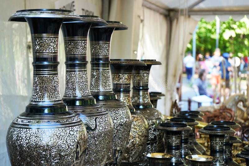 Black vases with gilded ornaments in a street shop royalty free stock photos