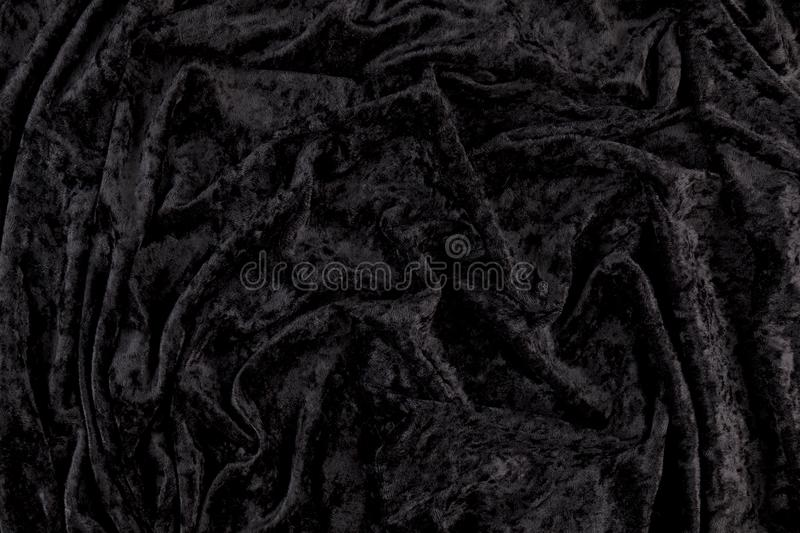 Black velvet cloth background with wrinkles royalty free stock photography