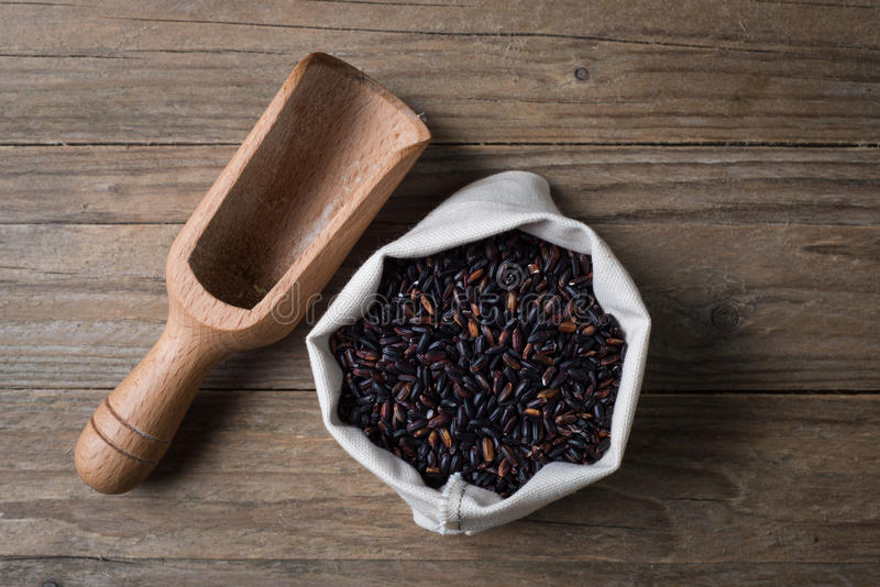 Black venere rice with bailer. Riso integrale venere con sassolagluten free seeds royalty free stock images