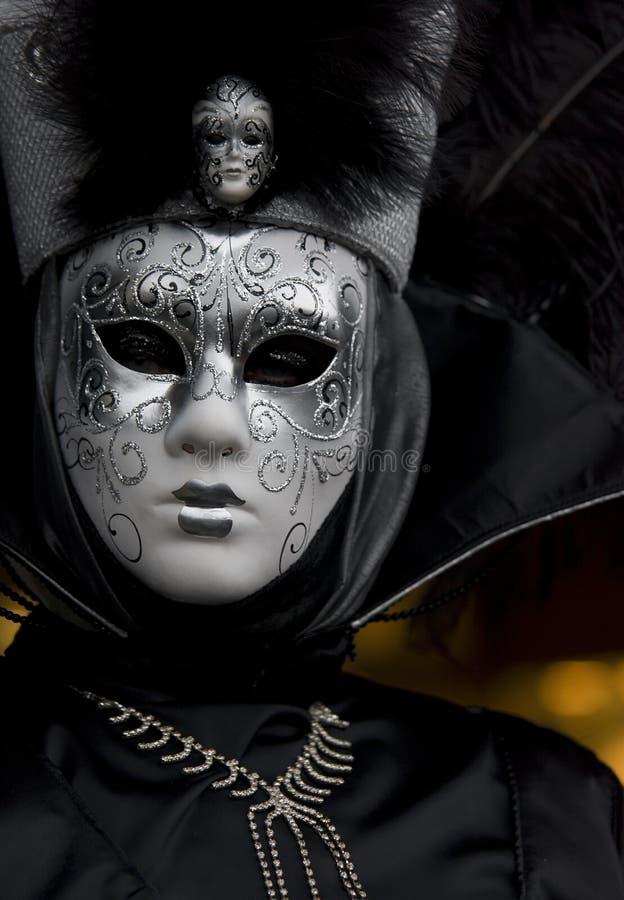 Black venetian mask 2. Black venetian mask yellow background royalty free stock photo