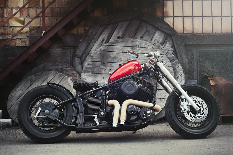 Black Vintage custom motorcycle bobber in the industrial background royalty free stock images