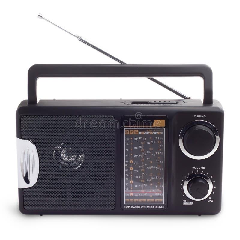 Black vintage radio to listen to isolated station royalty free stock photo