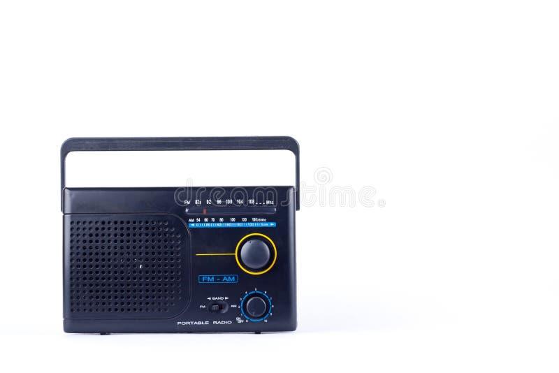 Black vintage retro style AM, FM portable radio transistor receiver on white background isolated stock image