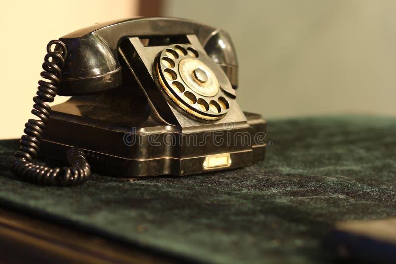Black vintage soviet rotary dial telephone. Black old vintage soviet rotary dial telephone royalty free stock photo