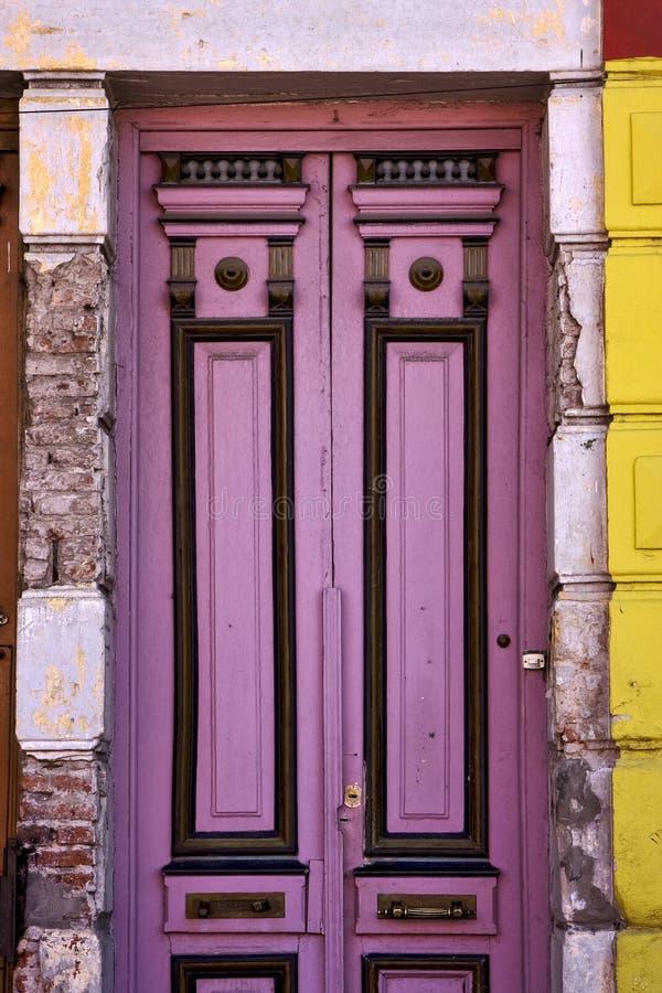 Black violet wood old door in the centre of la boca. A black violet wood o ld door in the centre of la boca buenos aires argentina stock images
