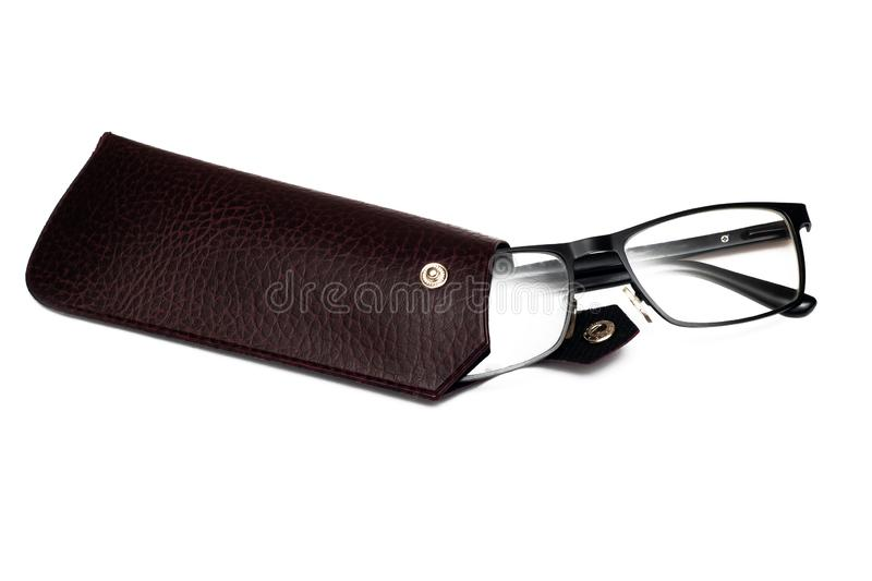 Black vision glasses in a brown leather case, isolated on white stock photography