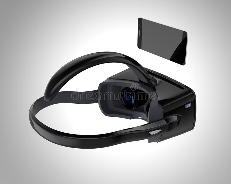 Black VR headset and smartphone isolated on gray background. royalty free stock photos
