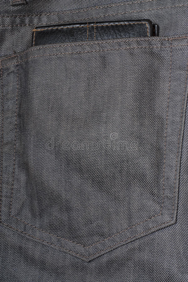 Black wallet in the back pocket of jeans stock photo