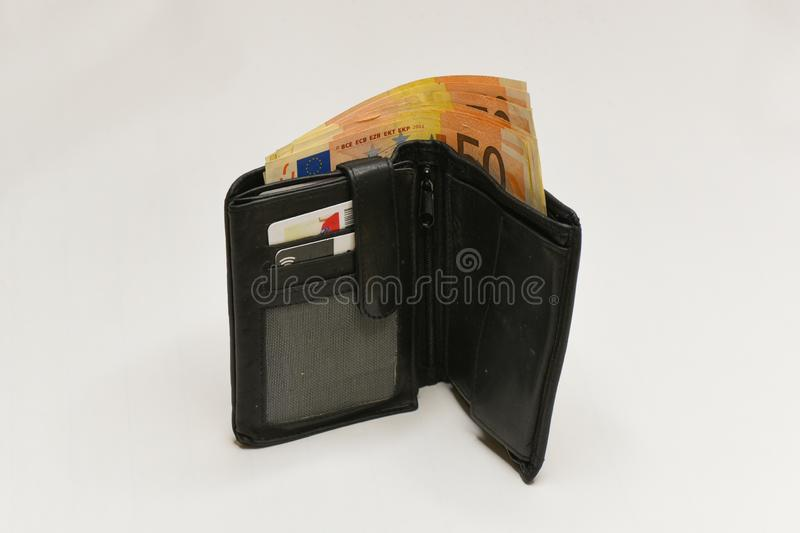 Euro money banknotes and wallet. isolated. Black wallet and 50  euro bills isolated on white background royalty free stock photo