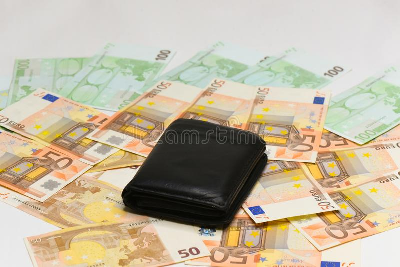 Euro money banknotes and wallet. isolated. Black wallet and euro bills isolated on white background stock photo