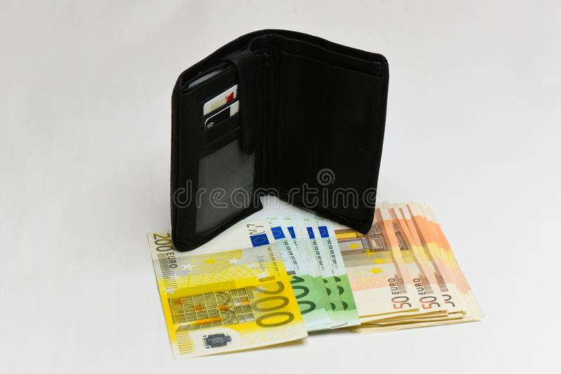 Euro money banknotes and wallet. isolated. Black wallet and euro bills isolated on white background stock photos