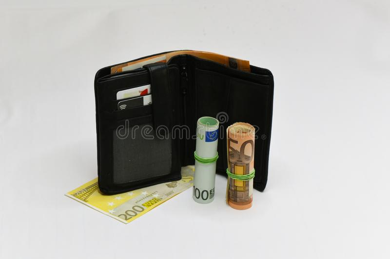 Euro money banknotes and wallet. isolated. Black wallet and euro bills isolated on white background stock photography