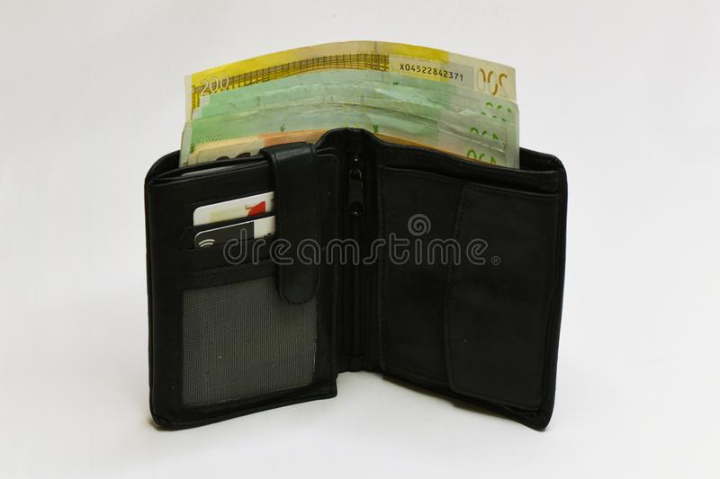 Euro money wallet. isolated. Black wallet full with  euro bills isolated on white royalty free stock photo
