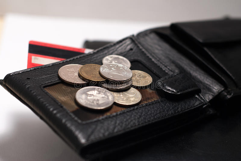 Black wallet, leather diary and coins. stock image