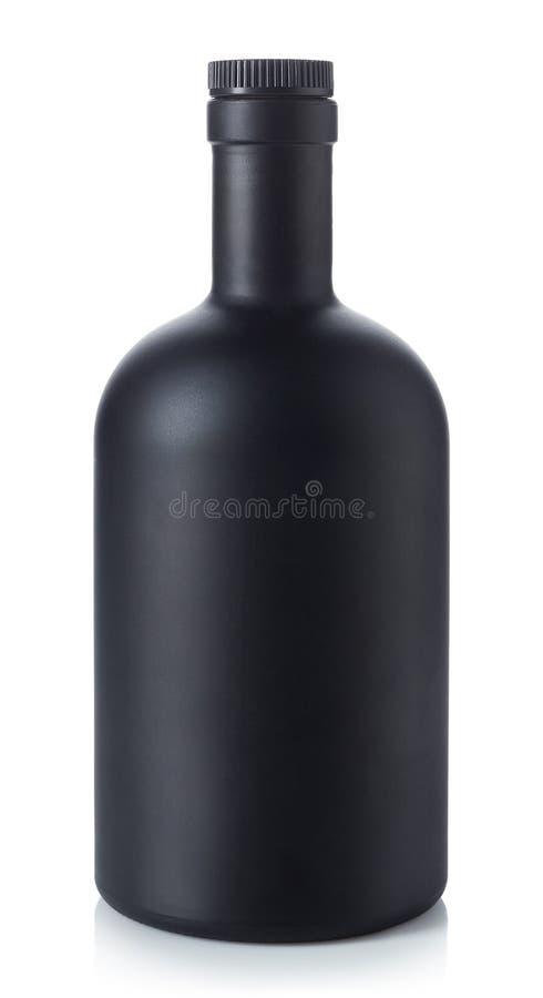 Black whiskey bottle on white background royalty free stock photo