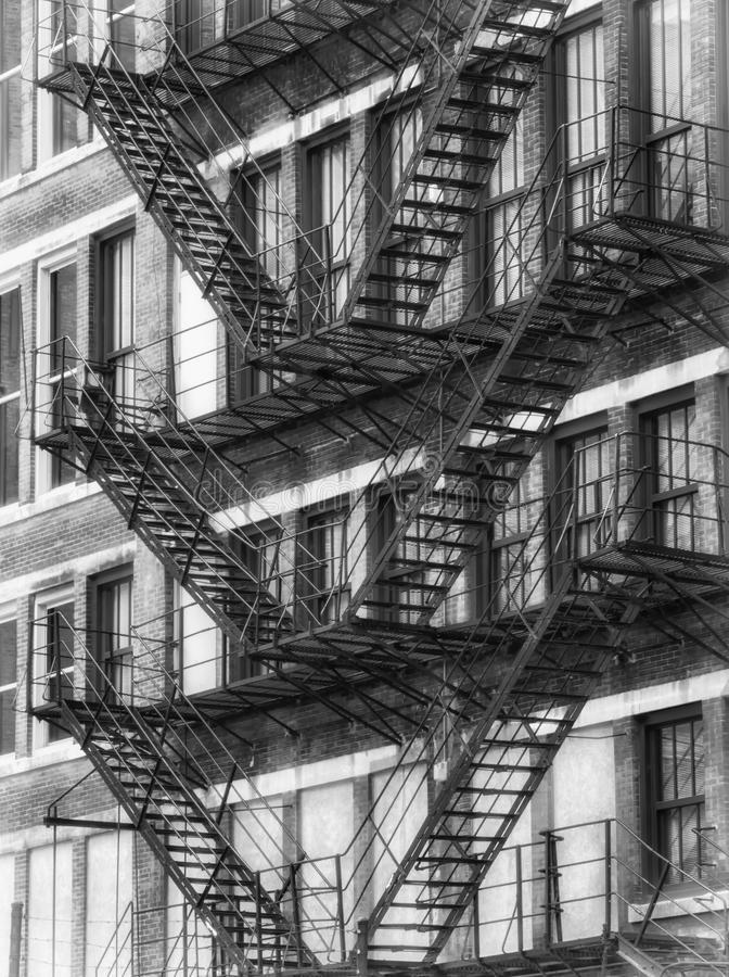 Black and White American fire escapes on an old building at Chicago Center stock photography