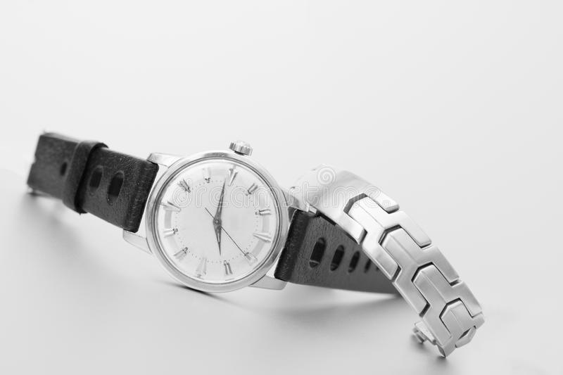 Black and white angled watch with steel bracelet royalty free stock image