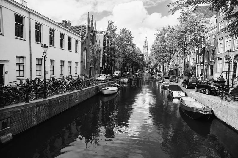 Black and white art monochrome photography. A beautiful European city. Euro-trip. Spring sunny Amsterdam. The bright clear sky with white clouds. Boat trip on stock photography