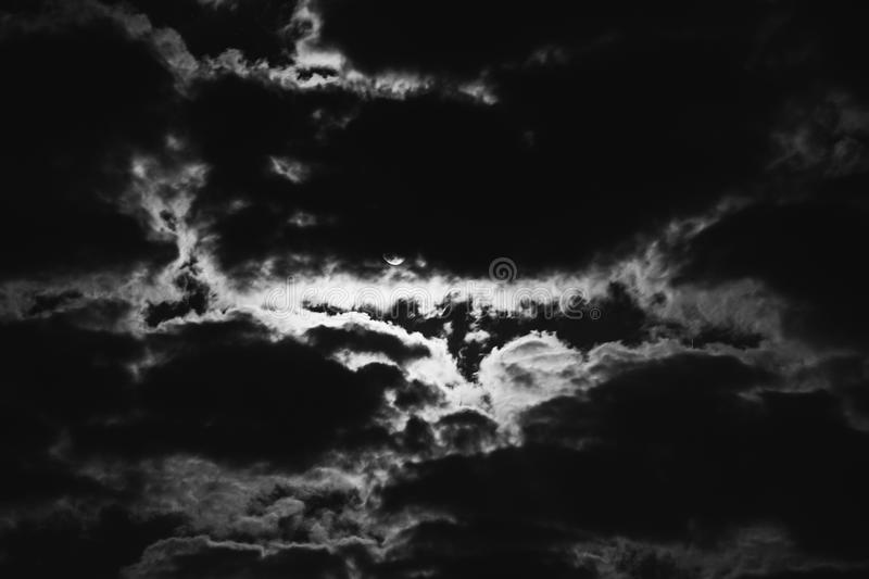 Art black and white photography. Black and white art photography monochrome, night is dark gloomy sky. The moon shines through the clouds. Full moon. Gothic royalty free stock images