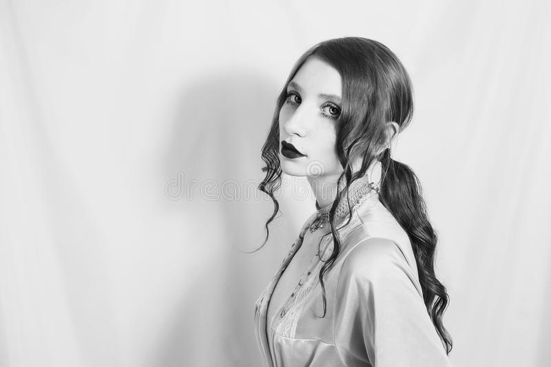 Artistic black and white photography. Unusual appearance. Black and white art photography monochrome, girl with the hair gathered in a ponytail holding a lilac stock photos