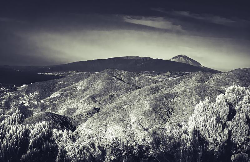 Black and white art view over the island of Tenerife to the volcano Pico del Teide stock images