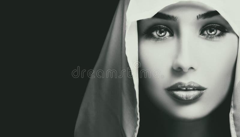 Black and white artistic closeup portrait of beautiful serious woman. Black and white artistic closeup portrait of beautiful serious young woman royalty free stock image