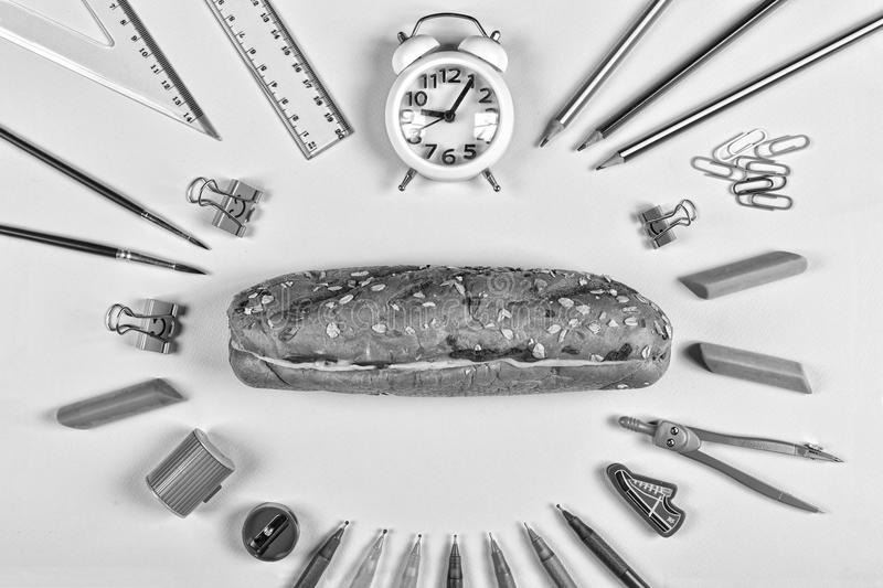 Black and white. Back to school concept. education, school snack, school supplies, student, college, flatlay, eating outdoor royalty free stock photo