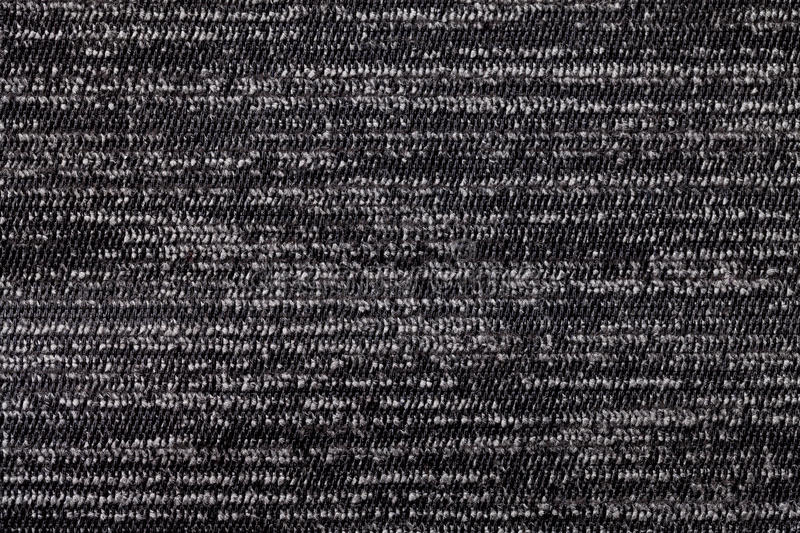 Black and white background from soft textile material. Fabric with natural texture. royalty free stock images