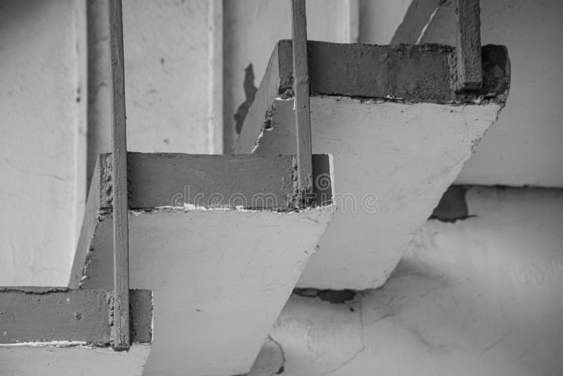 Monochrome background of stone stairs and metal construction stock image