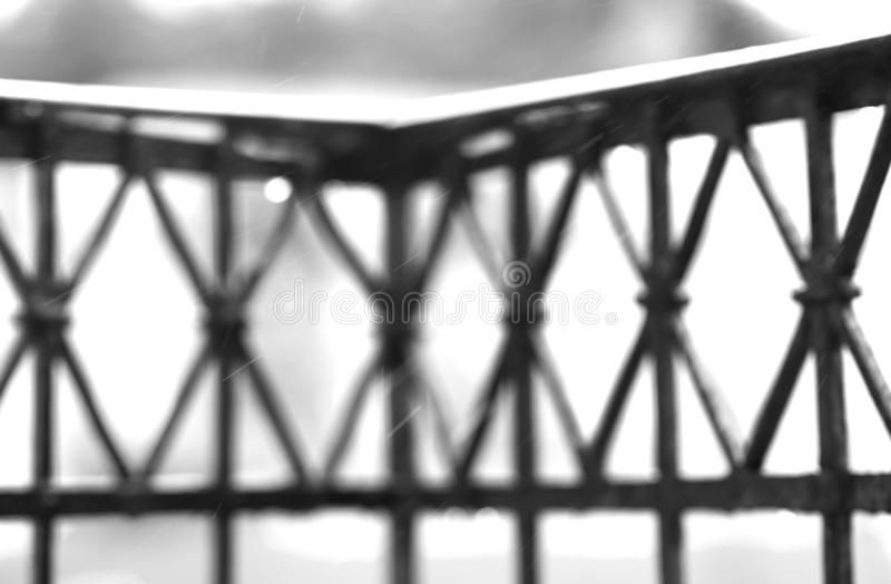Black and white balcony fence with rain drops background royalty free stock photos