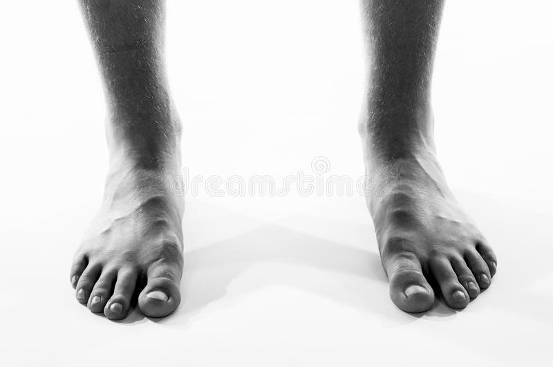 Black and white barefoot male feet stock photo